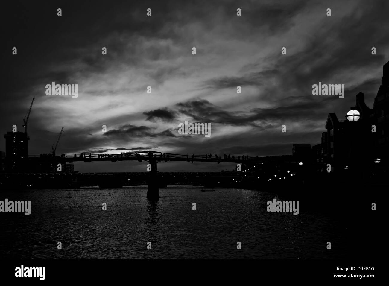 A Black And White Image Of The River Thames With Millennium Bridge At Night