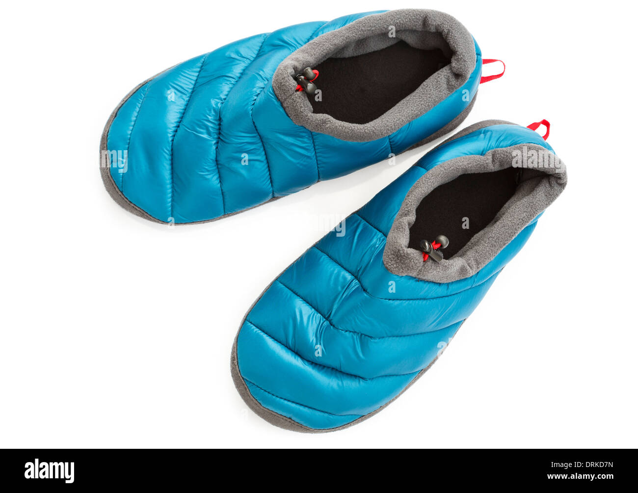 Top down of a pair of cosy warm blue cabin slippers isolated cut out on a white background from above - Stock Image