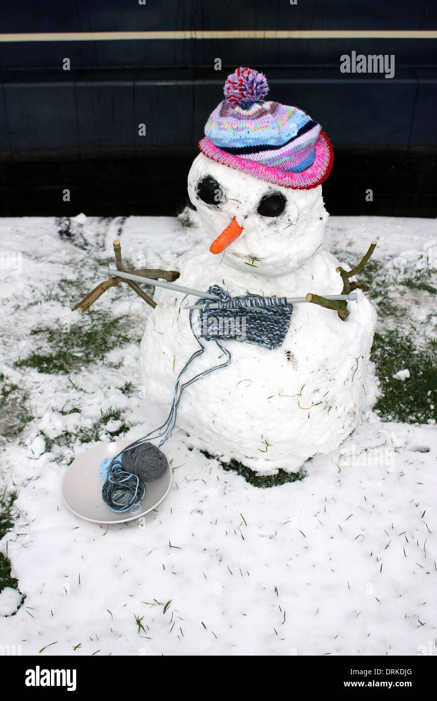 """Kevin, a snowman made by the crew of """"The Wool Boat"""" who learned to knit in January 2013 Stock Photo"""