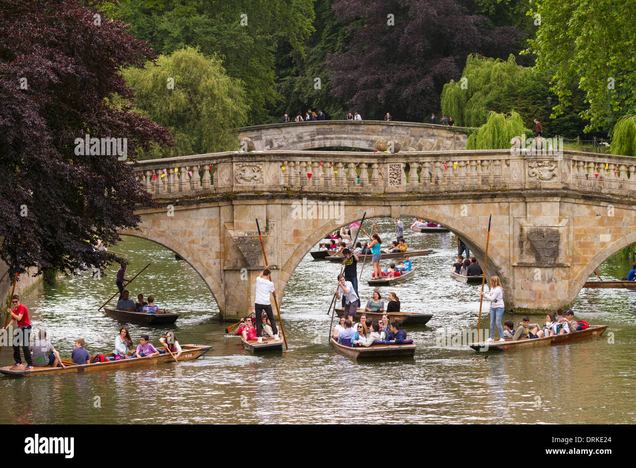 People punting on River Cam Clare Bridge background, Cambridge, England - Stock Image