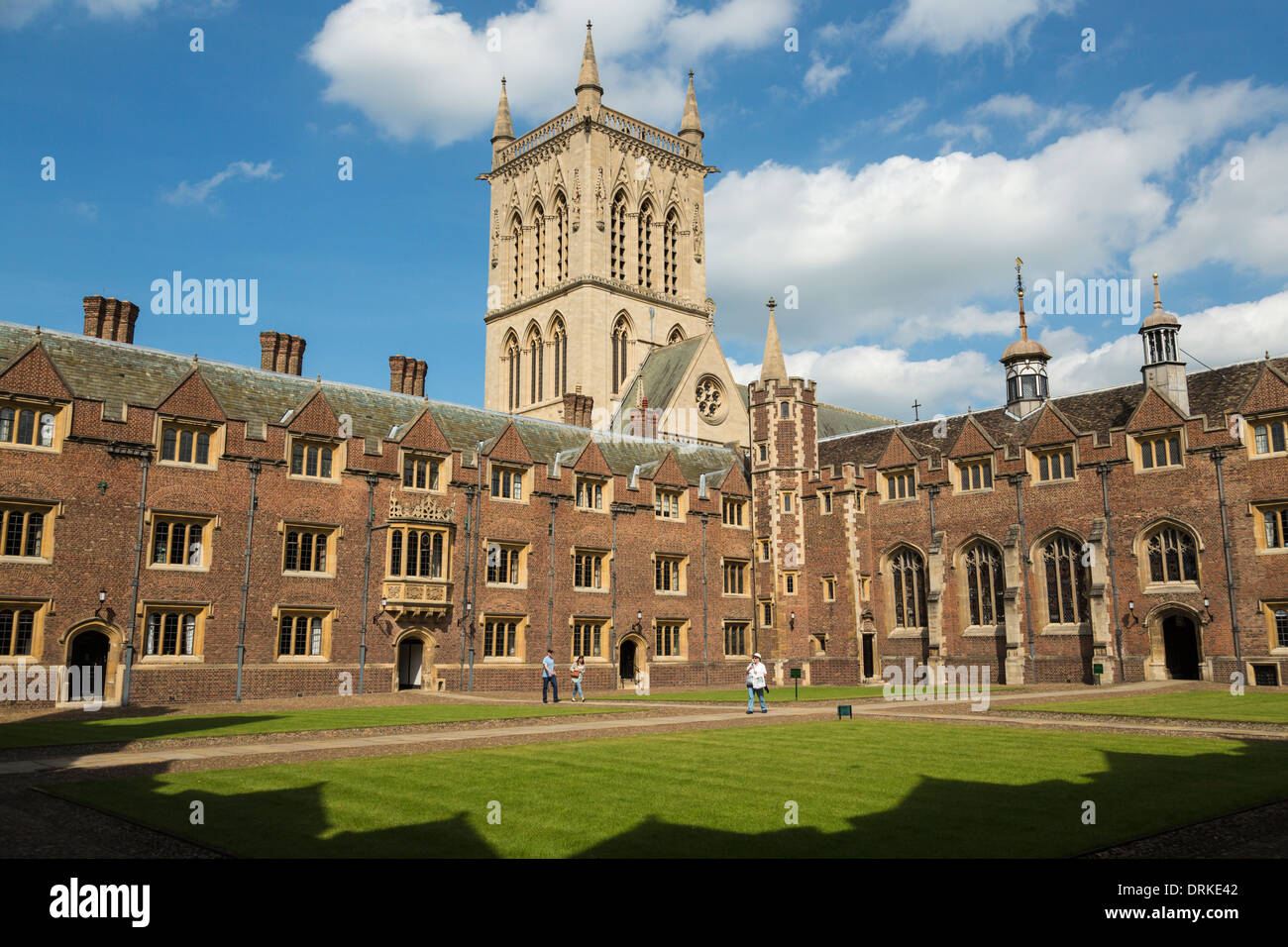 Tourists visit St Johns College, Cambridge, England on sunny day - Stock Image
