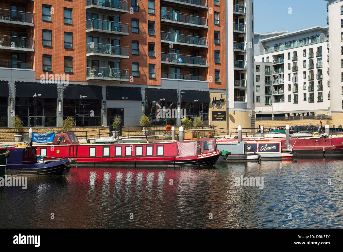 Mumtaz restaurant boats and apartment buildings at Clarence Dock, Leeds, England - Stock Image