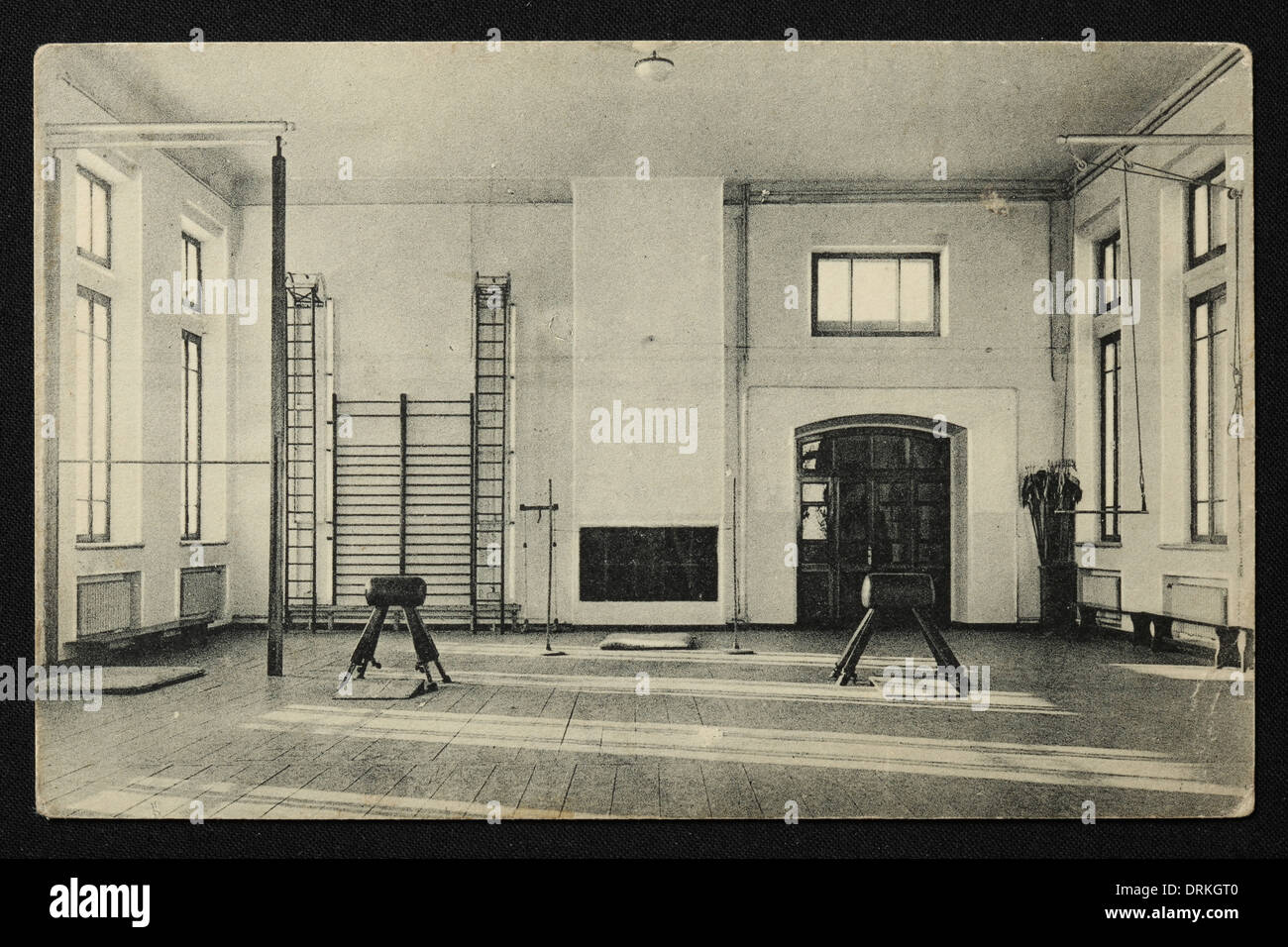 Gym in the Men's Gymnasium in Yekaterinburg, Russian Empire. Old postcard. - Stock Image
