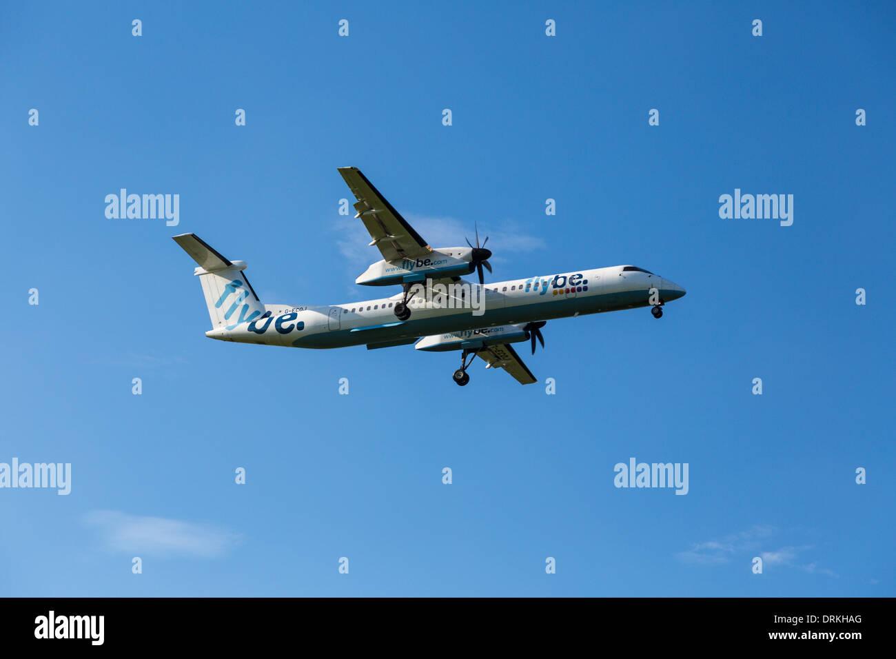 Flybe De Havilland dash 8 to land - Stock Image