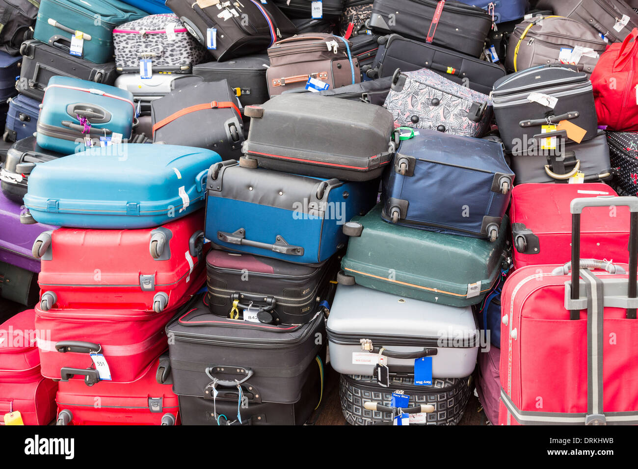Baggage on cruise ship to be off loaded - Stock Image