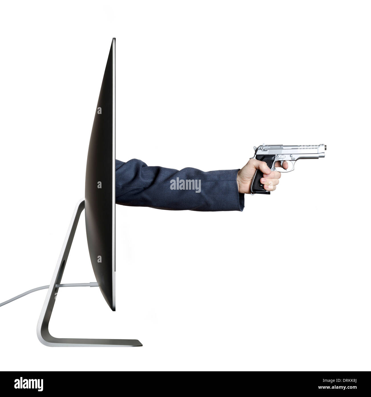 Hand holding a gun, extending out from a computer screen. - Stock Image