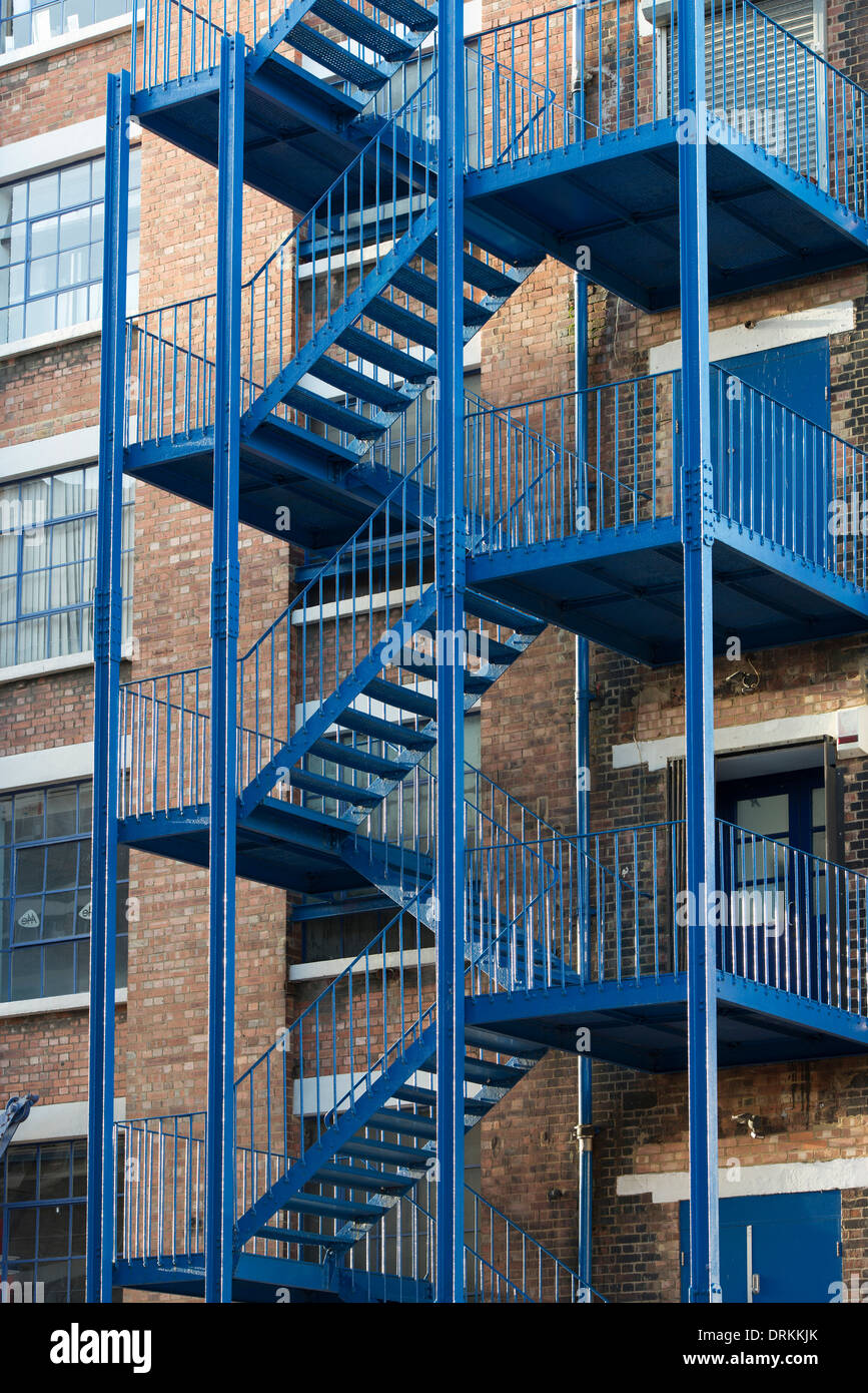 Blue External Fire Escape Staircase On Contemporary Workspace In Victorian  Brick Former Warehouse At Highgate Studios