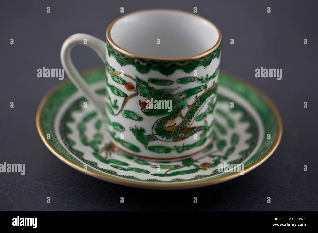 Chinese teacup and saucer with dragon pattern - Stock Image