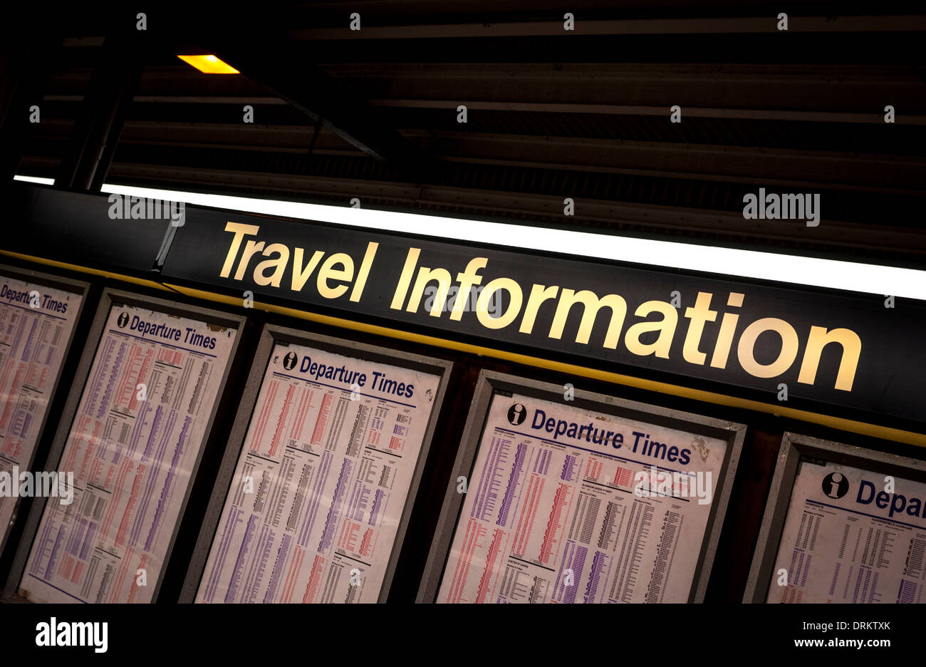 Travel information board at railway station - Stock Image