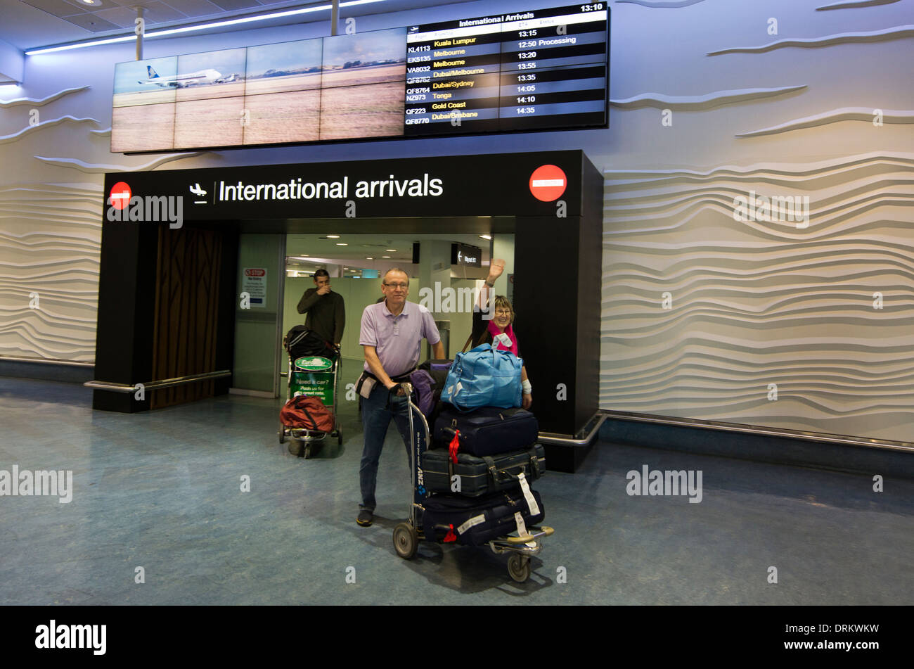Visitors arrive to Auckland Airport - Stock Image