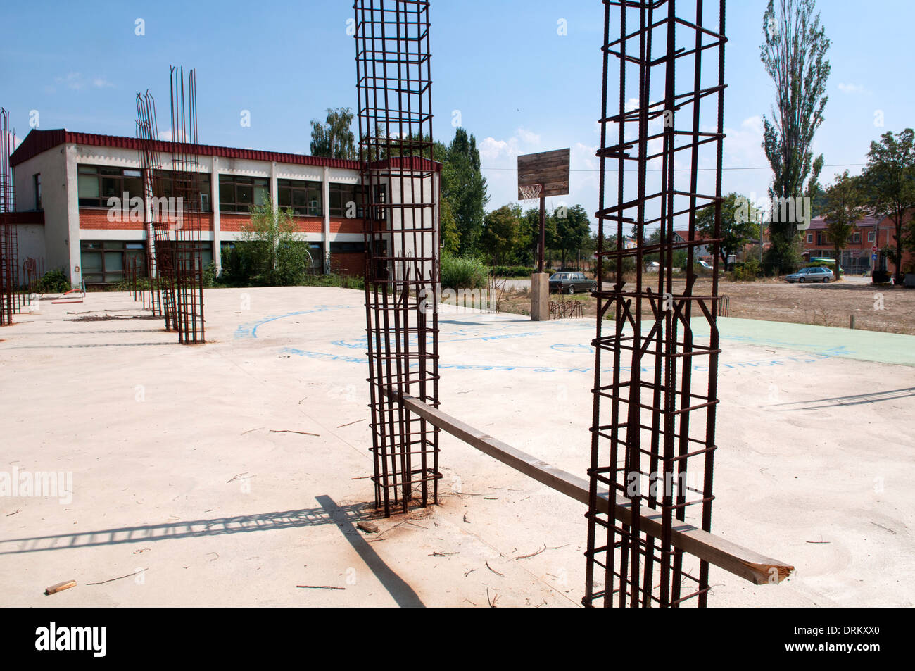 A basketball court among rebars, Peć, Kosovo Stock Photo