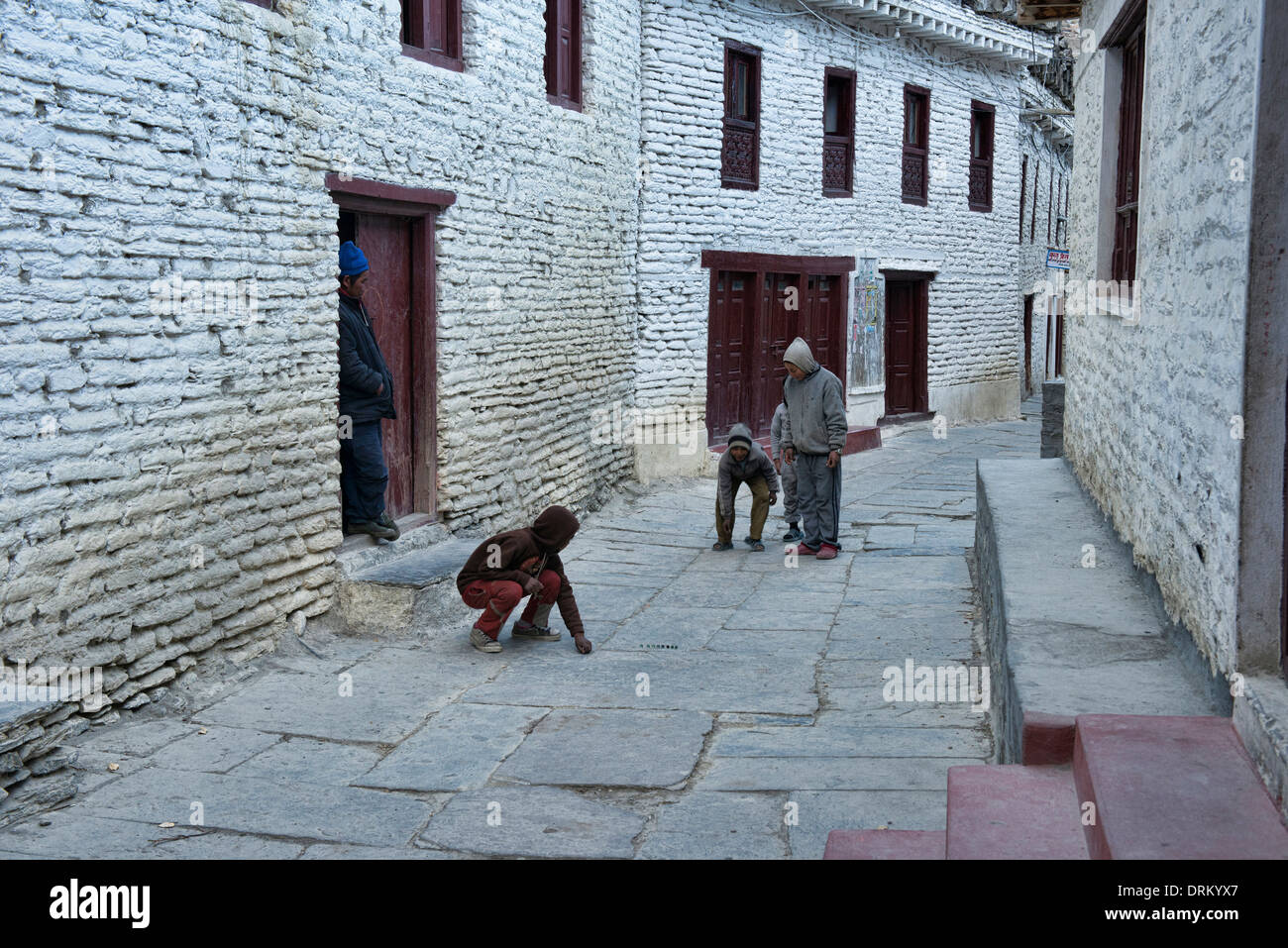 playing marbles in Marpha village in the Annapurna region of Nepal - Stock Image
