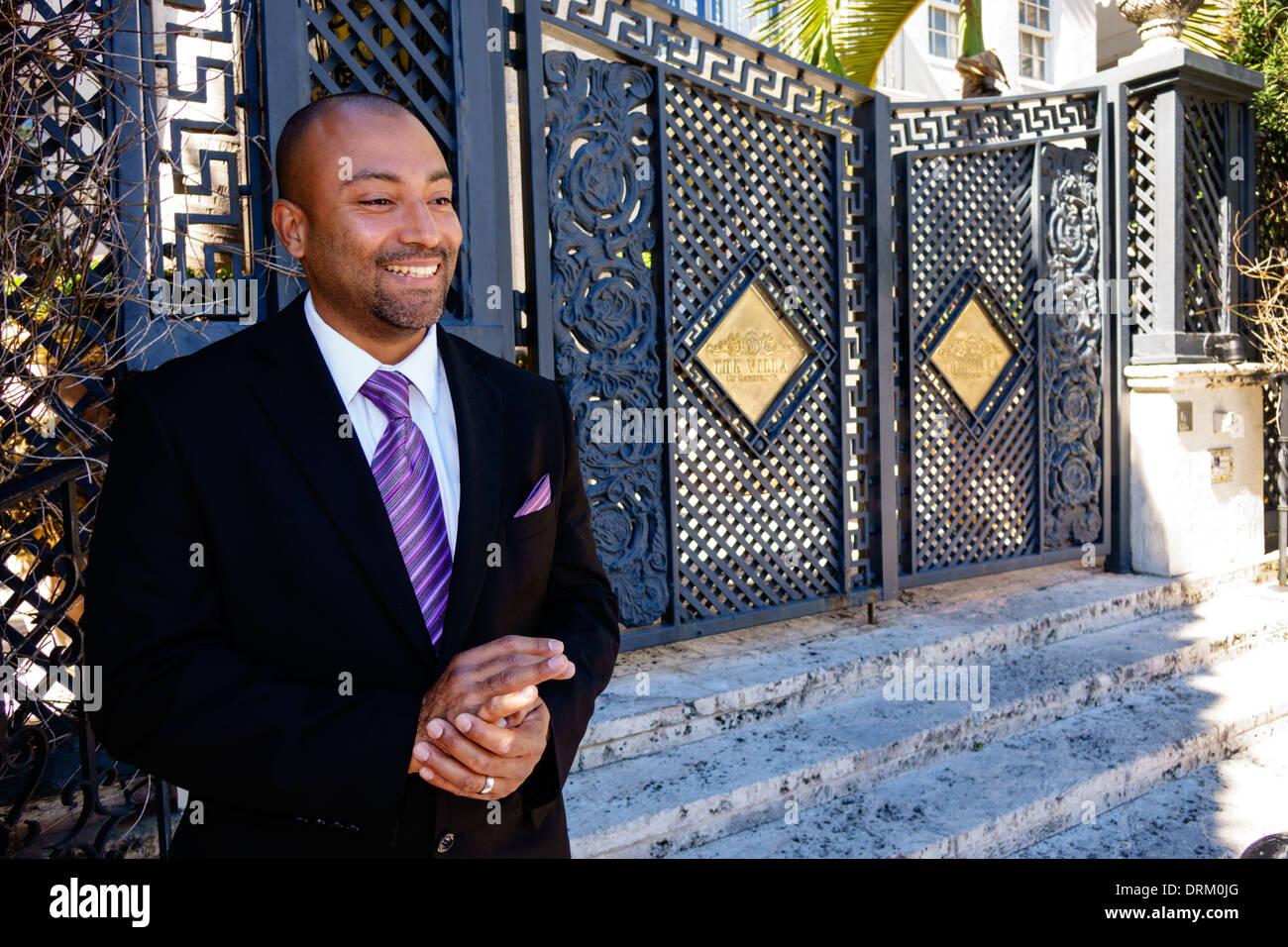 Miami Beach Florida Ocean Drive Casa Casuarina gate entrance security guard Black man The Villa by Barton G - Stock Image
