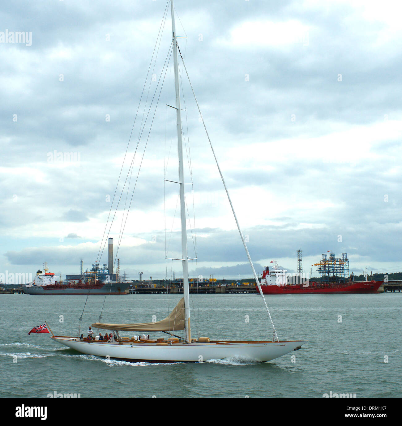 Lone white classic yacht motoring in Southampton Water - Stock Image