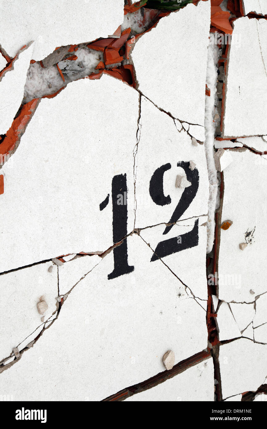 Spain, Catalonia, building site, number 12 on a cracked wall - Stock Image