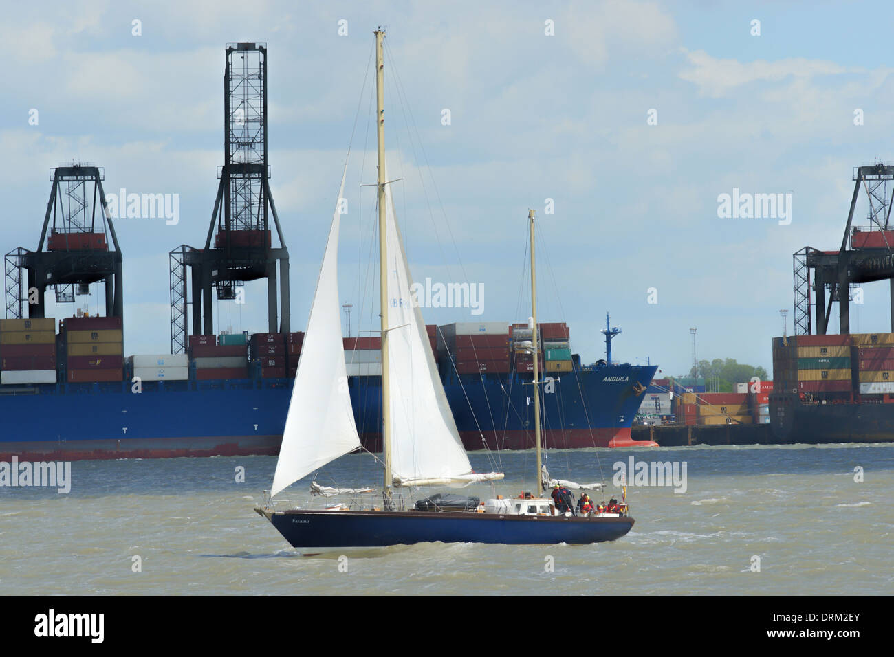 22.4m ketch Faramir in Harwich harbour, Harwich, Essex UK with container ship anguila in the background. - Stock Image