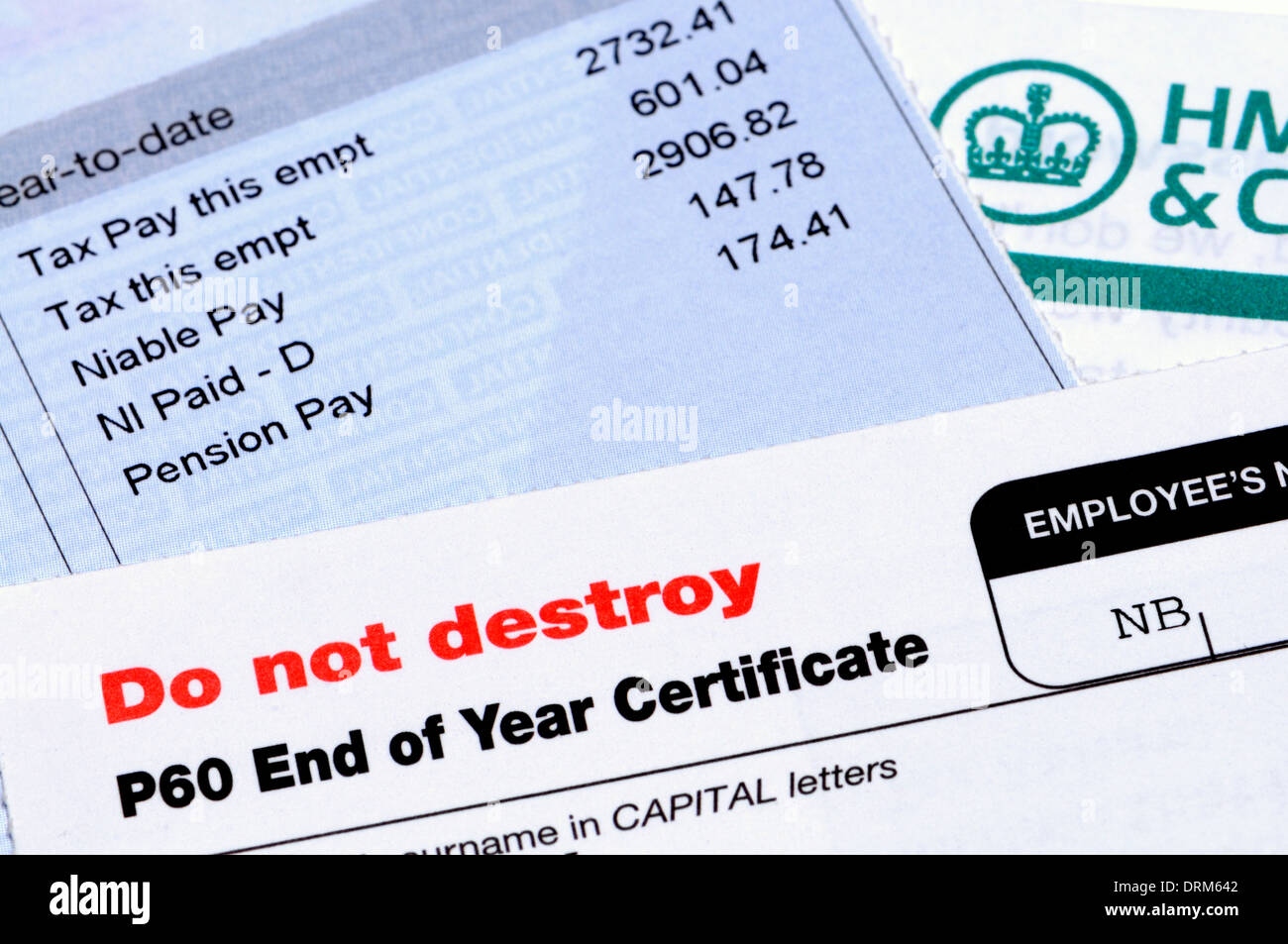 HMRC tax documents - P60 end of year certificate and pay slip - Stock Image