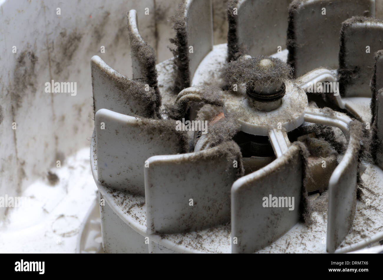 Interior of an old electric fan heater - very dusty - Stock Image