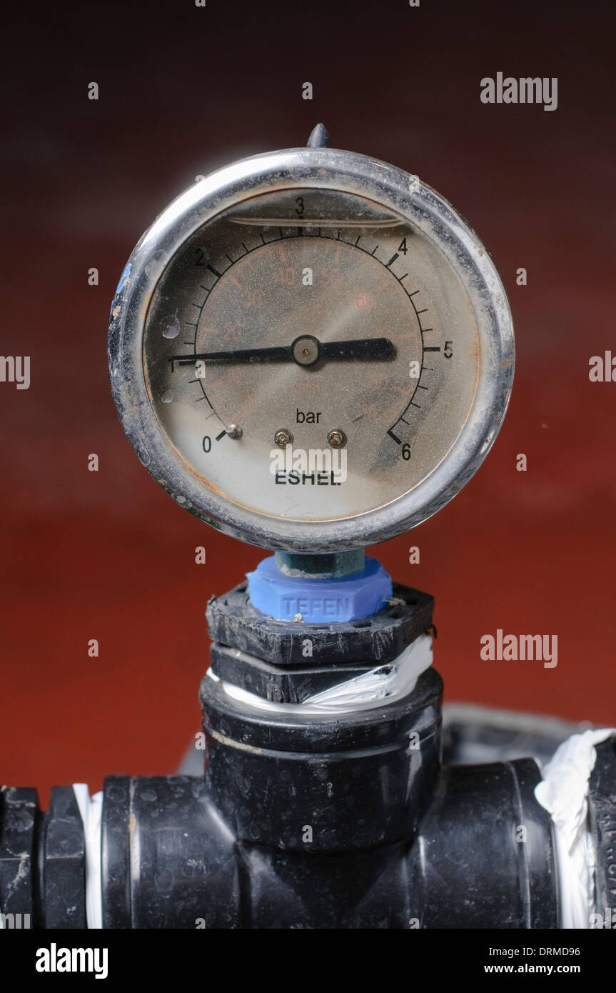 Water pressure gauge on a pipe - Stock Image