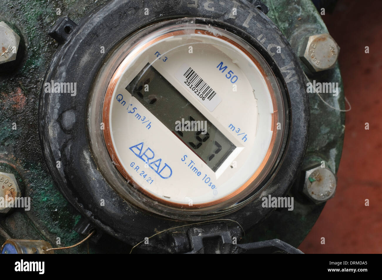 Water flow meter with digital display measures the hourly flow of the water in cubic metres - Stock Image