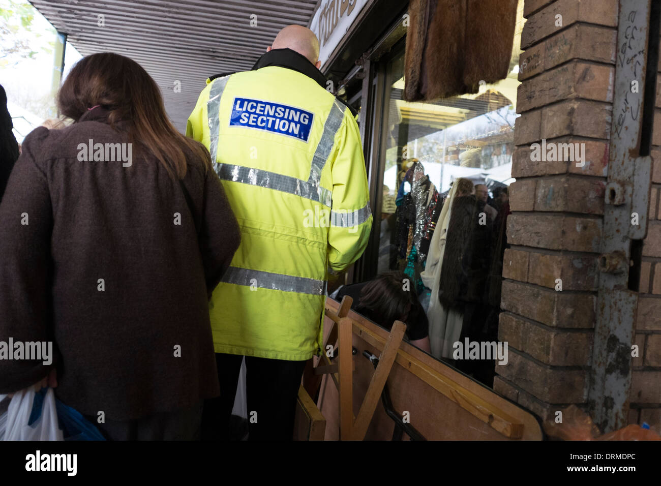 Council Trading Standards Licensing Officer Raid - Stock Image