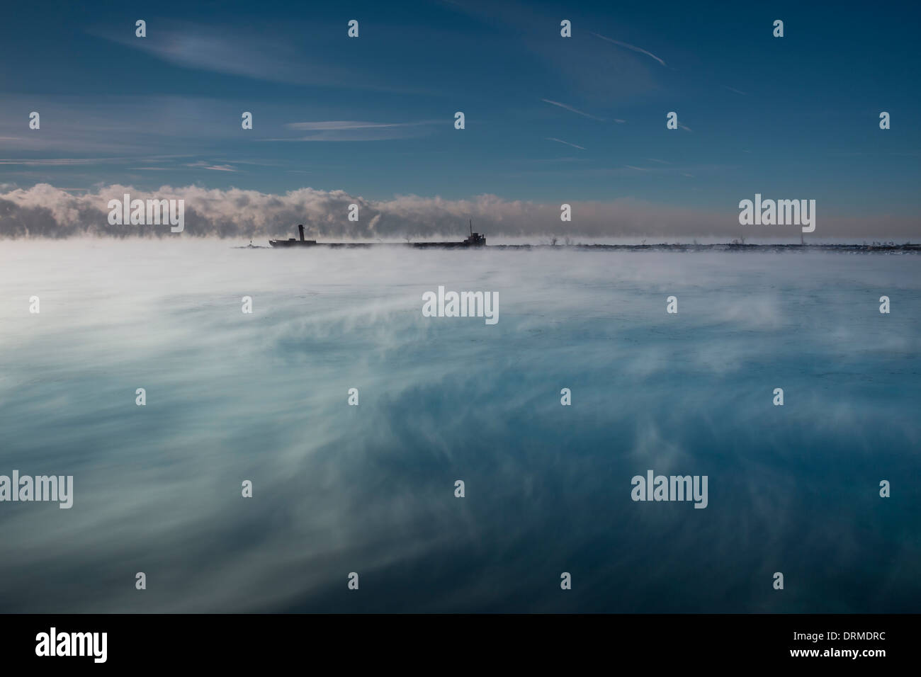 Waves of steam fog waft along the water of Lake Ontario as a frigid minus -25C airmass engulfs the region - Stock Image