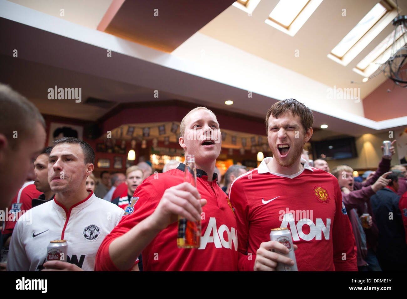Football fans at Old Trafford in Stretford, the home of Machester United Football Club, Manchester, North England, UK - Stock Image