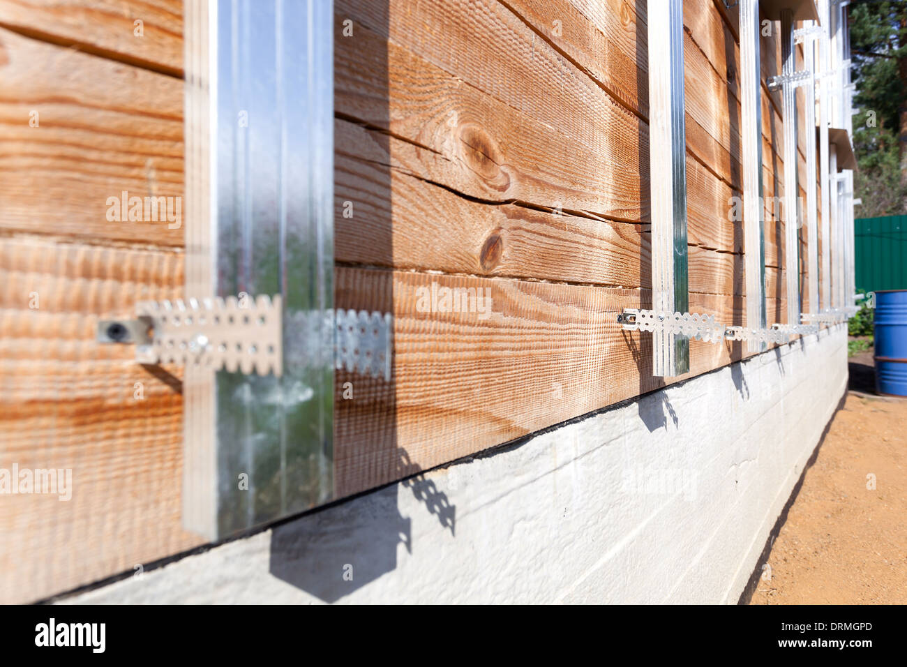 Building house, installation of galvanized crate, preparing for insulation and siding - Stock Image