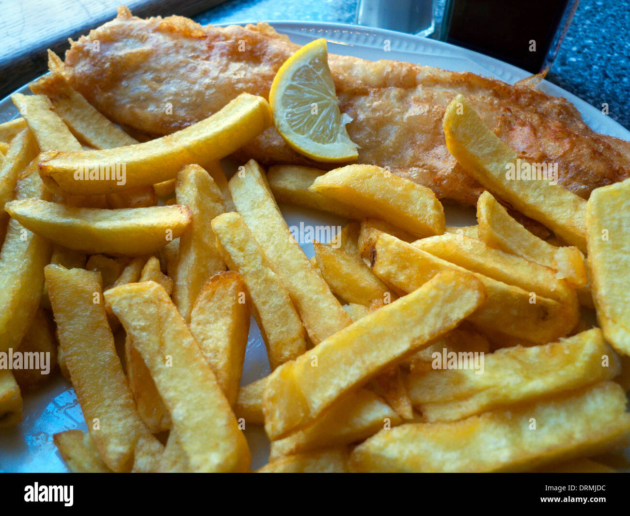 Fish and chips meal on a plate in Lloyds take-away shop in Lampeter Ceredigion Wales UK   KATHY DEWITT - Stock Image