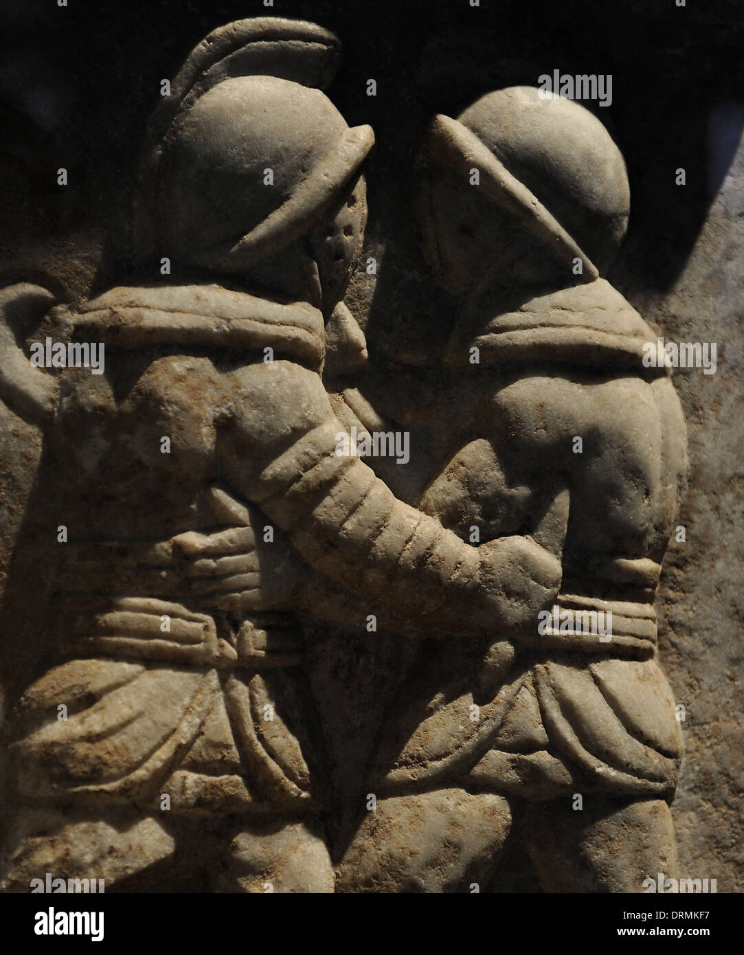 Roman relief depicting a gladiatorial combat. Marble. 3rd century AD. From Ephesus, Turkey. - Stock Image