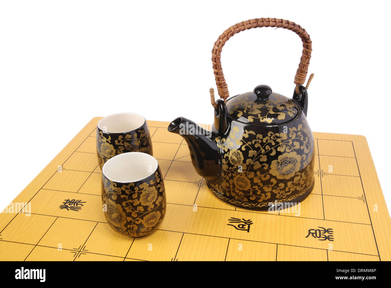 tea service on chessboard - Stock Image