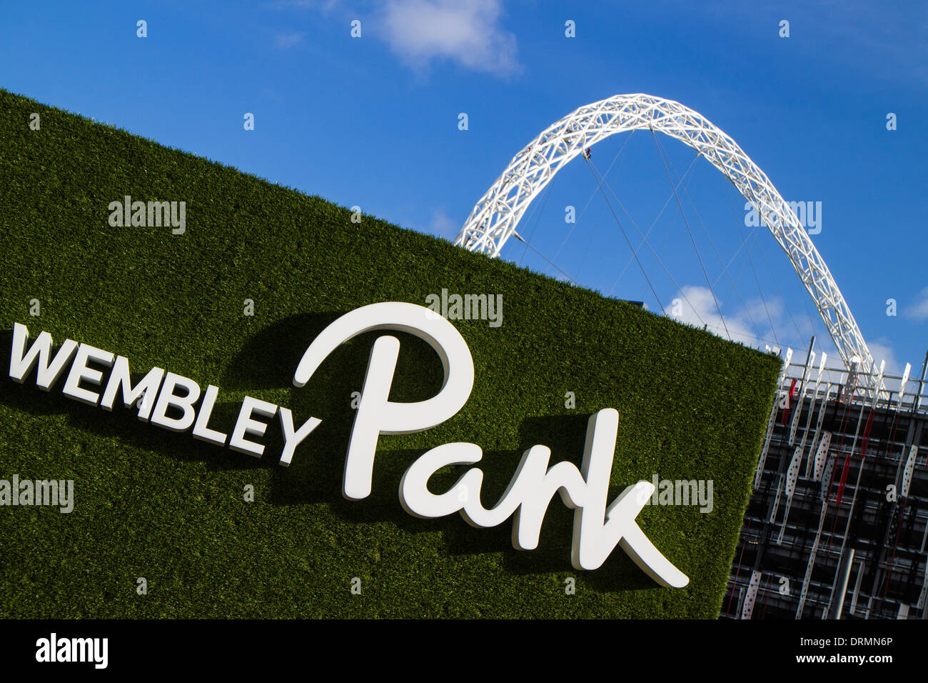 Wembley Park name board in front of Wembley stadium arch - Stock Image