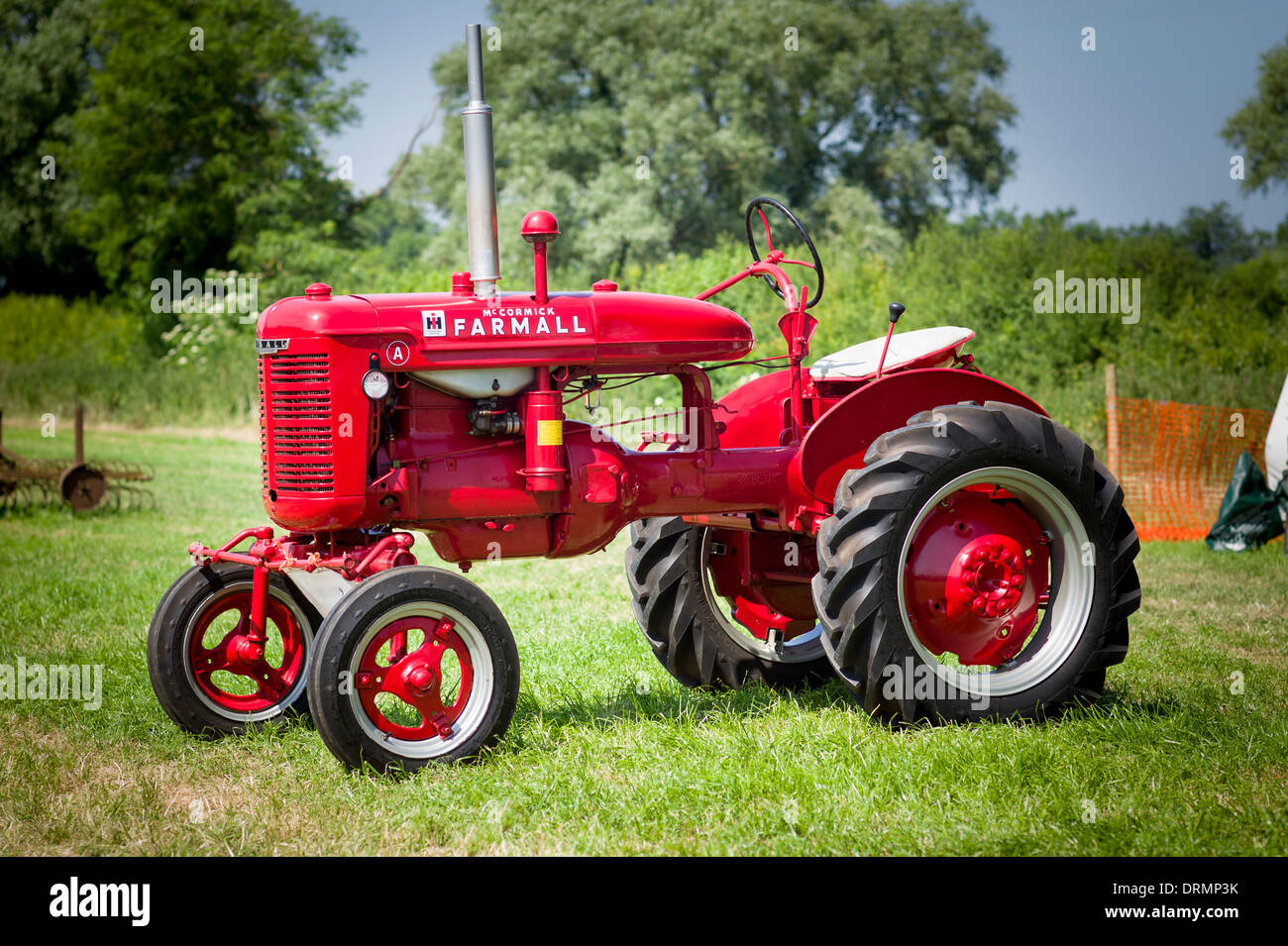 International Harvester FARMALL tractor restored and on show in England - Stock Image