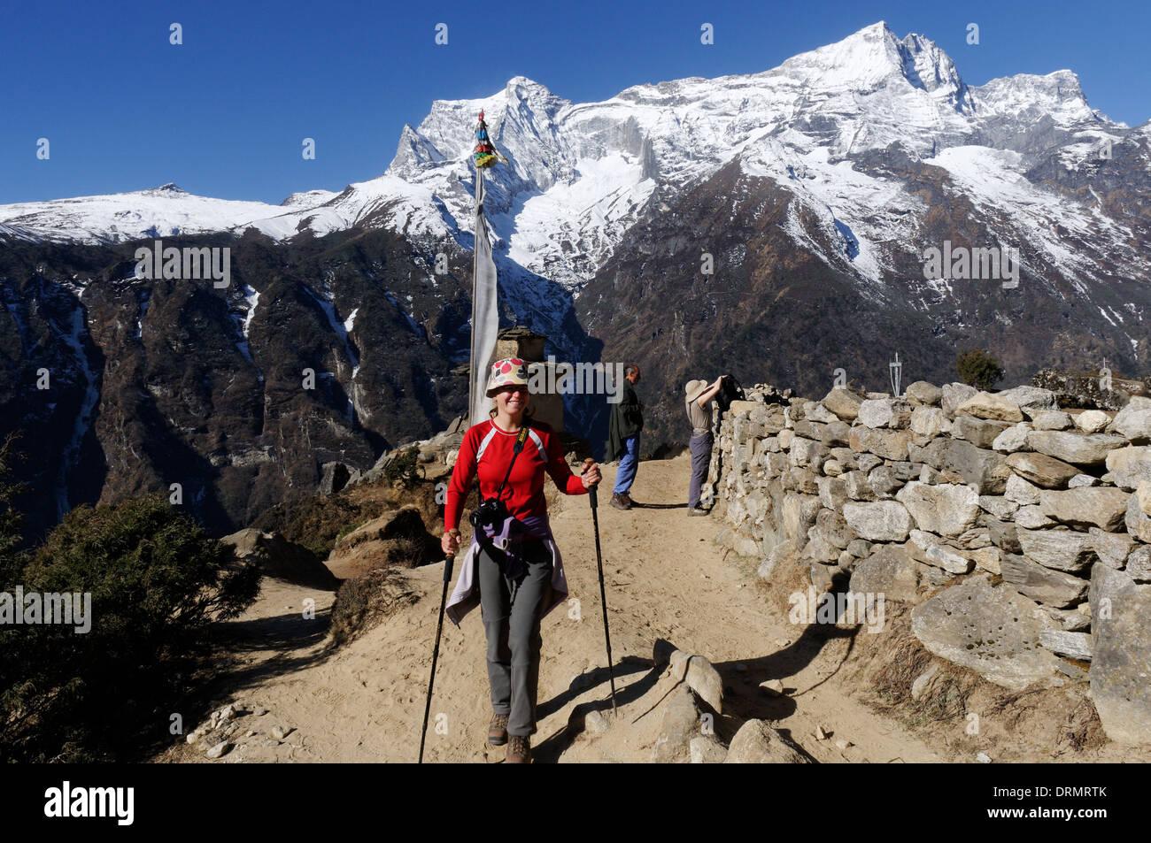 A lady trekker on the Everest base camp trek - Stock Image