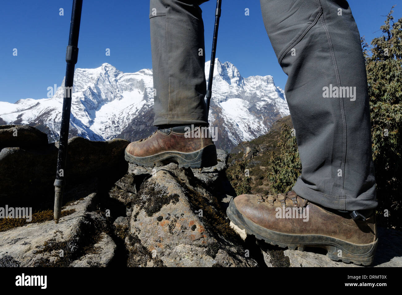 A trekkers boots and legs on the everest base camp trek in the Himalaya - Stock Image