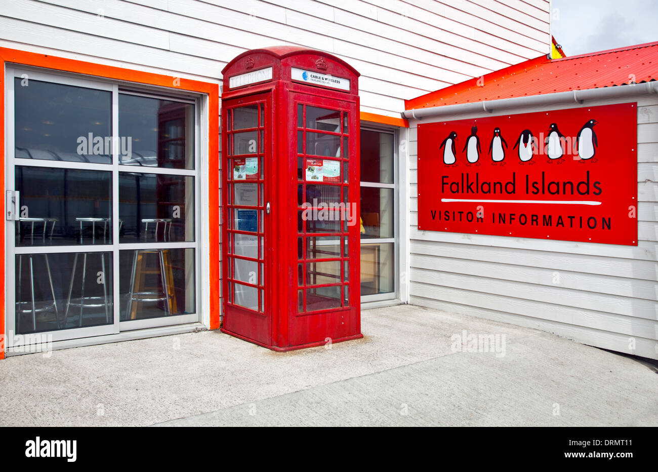 Traditional Red British Telephone Kiosk at the Visitor Information Centre, Stanley, Falkland Islands - Stock Image