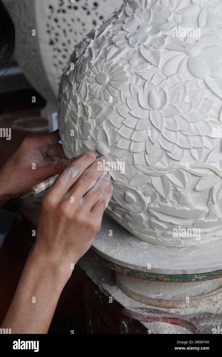 carve porcelain process - Stock Image