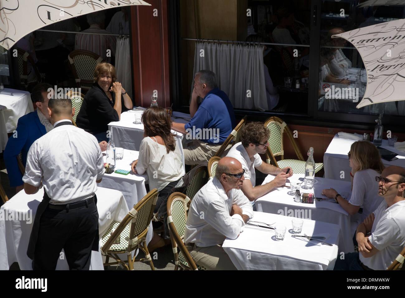 Diners on sidewalk restaurant San Francisco, CA, California, USA - Stock Image