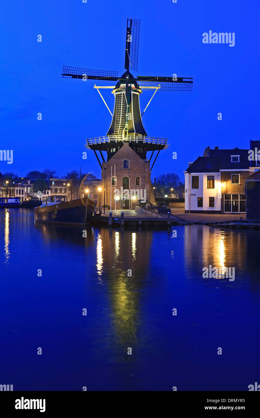 Windmill and Spaarne River at twilight, Haarlem, Netherlands - Stock Image