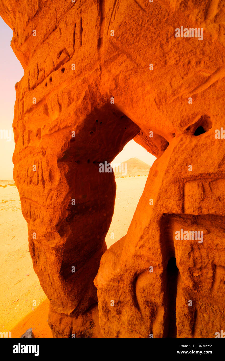 Natural arch framing distant peak, Saudi Arabia, desert areas near Riyadh - Stock Image