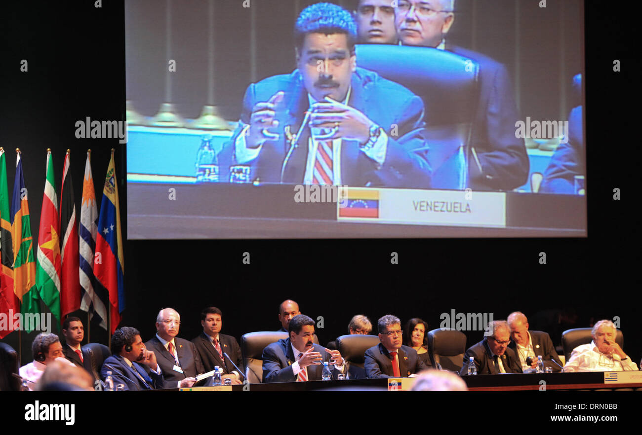 Havana, Cuba. 29th Jan, 2014. President of Venezuela Nicolas Maduro (C) is seen on a screen as he speaks during the second Summit of The Community of Latin American and Caribbean States (CELAC), in Havana, Cuba, on Jan. 29, 2014. The CELAC has declared the region a nuclear-free zone, Cuban leader Raul Castro announced Wednesday on the final day of the summit in Havana. Credit:  AVN/Xinhua/Alamy Live News - Stock Image