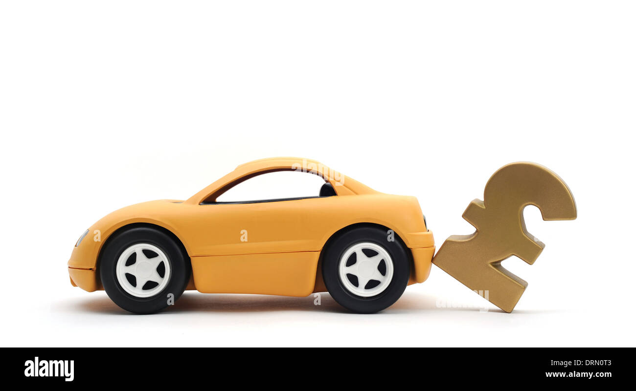 YELLOW CAR KNOCKING OVER BRITISH POUND SIGN RE INSURANCE POLICY MOTORING COSTS PRICES BUYING SELLING CARS NEW DEPRECIATION UK - Stock Image
