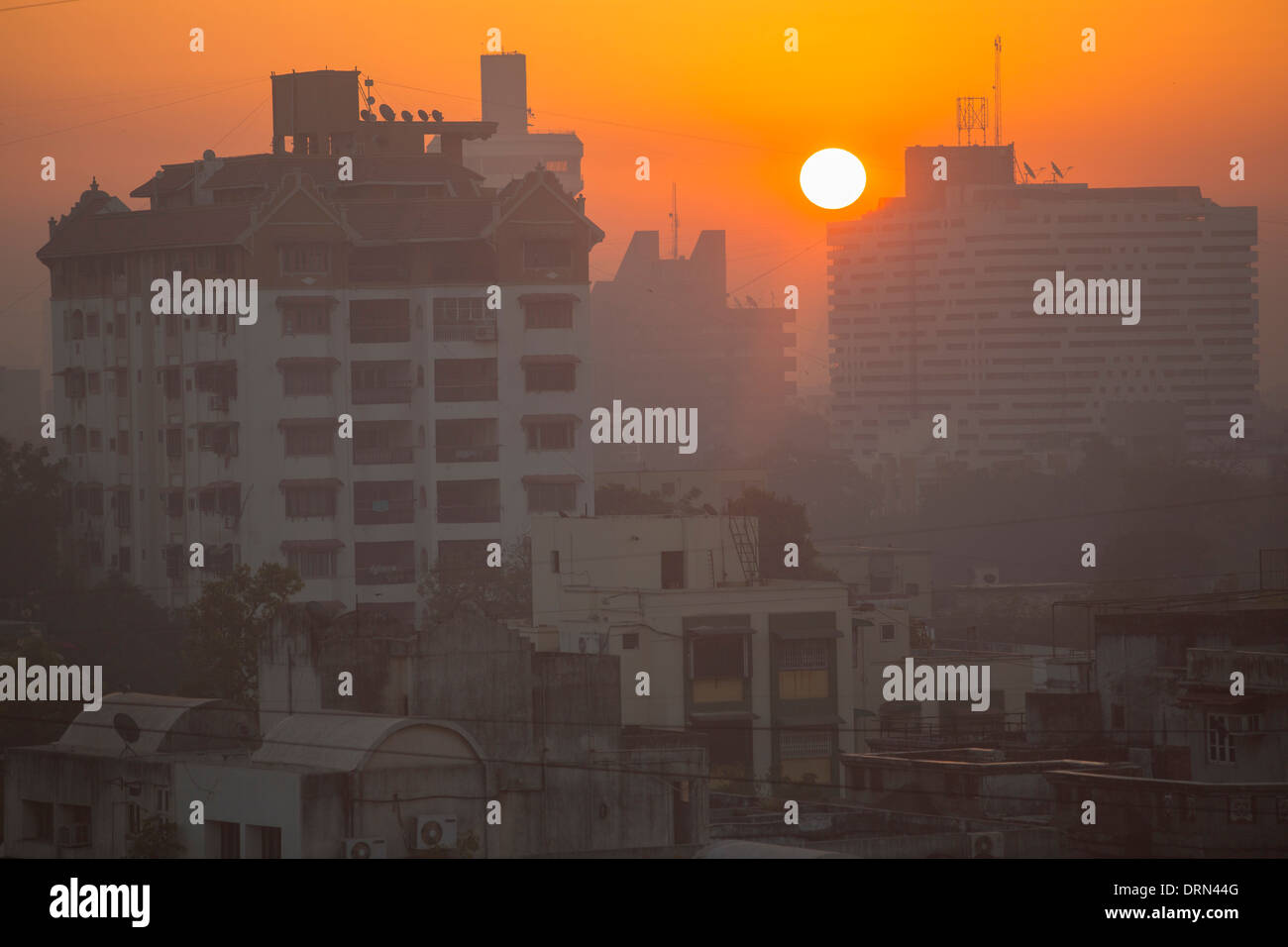 Sunrise over Ahmedabad; India, showing the poor air quality. - Stock Image