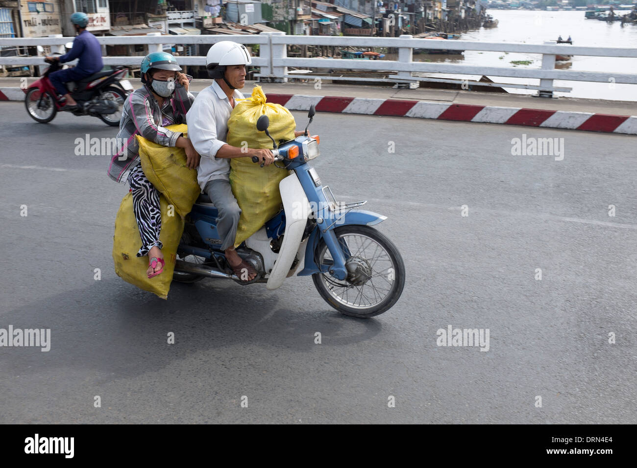 Carrying Sacks on Motorbike in My Tho - Stock Image