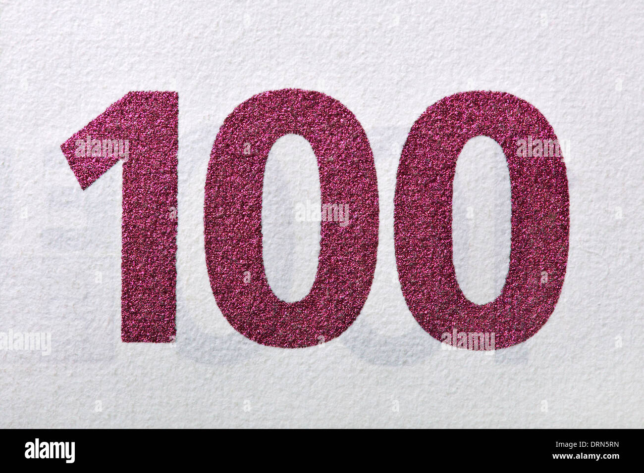 cypher one hundred, ruby colored, detail of an euro banknote. Stock Photo