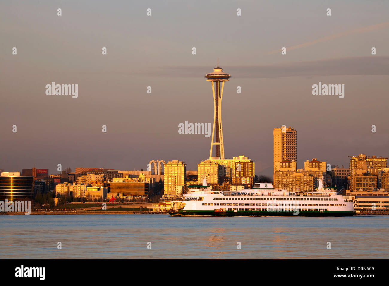 WASHINGTON - The Space Needle and a Cross-Sound ferry boat in Elliott Bay at sunset from West Seattle. Stock Photo