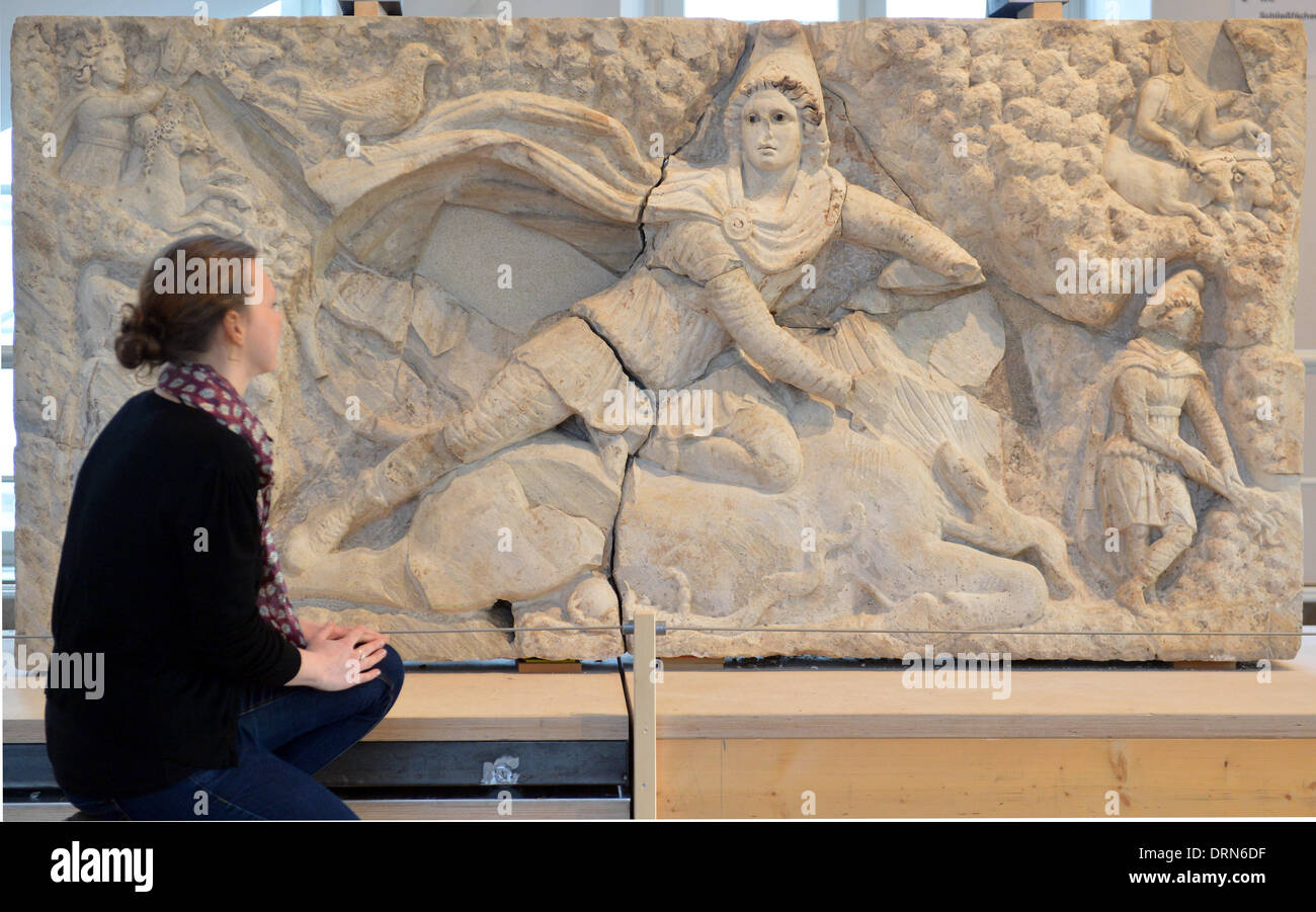 Karlsruhe, Germany. 29th Jan, 2014. ATTENTION PUBLICATION BLOCKING PERIOD THURSDAY 30 JANUARY 2014 4.30 PM The reconstructed Relief of Mithras of Tor Cervara in Rome is shown in Karlsruhe Palace at the Baden State Museum in Karlsruhe, Germany, 29 January 2014. The relief weighs two tons and was built in 150 AD. The antique artwork was damaged during a bomb attack, and stolen and sold in parts. The Baden State Museum (Badisches Landesmuseum) put the pieces together. Photo: Uli Deck/dpa/Alamy Live News - Stock Image