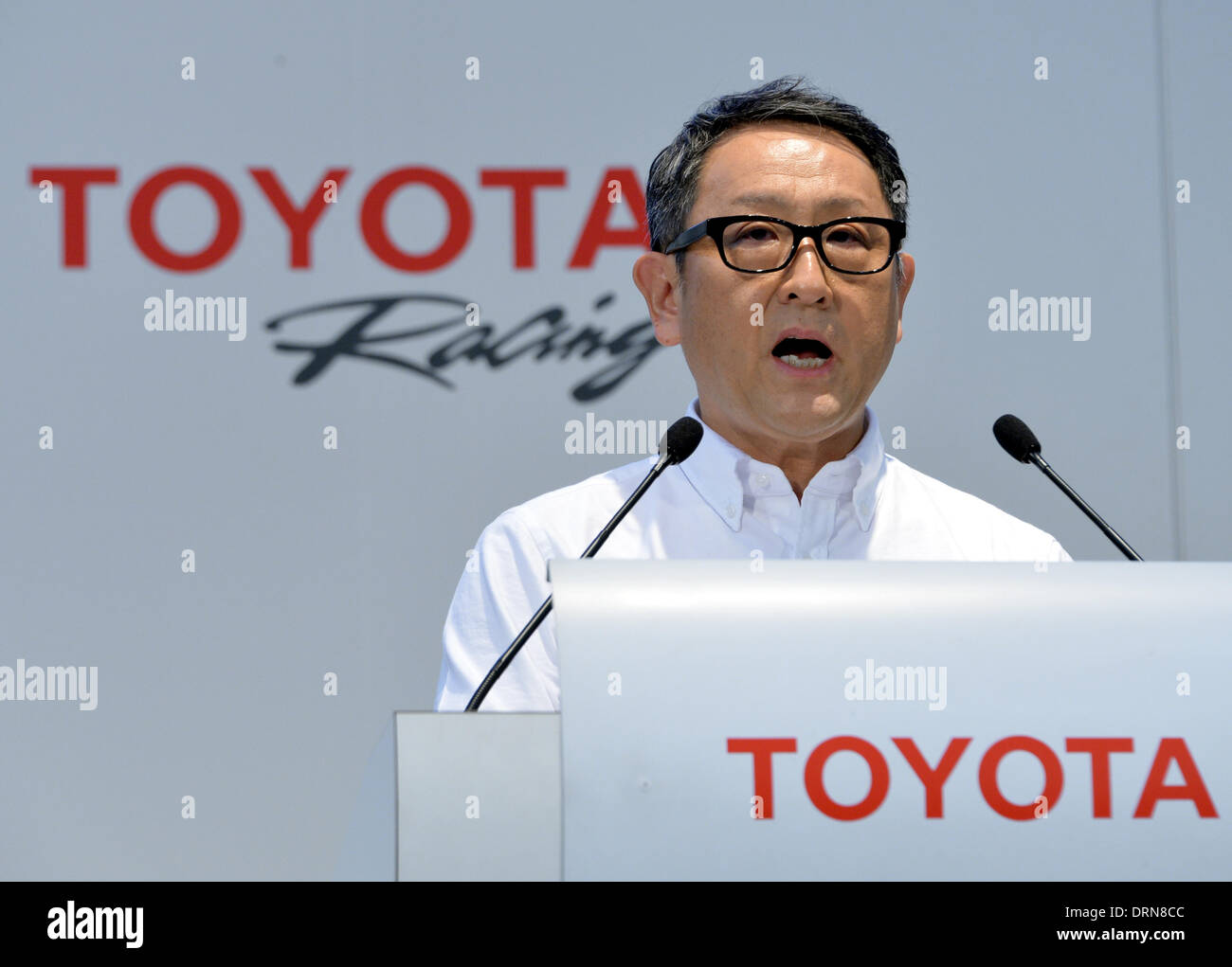 Tokyo, Japan. 30th Jan, 2014. President Akio Toyoda of Japan's Toyota Motor Corp., takes off his business suit for Stock Photo