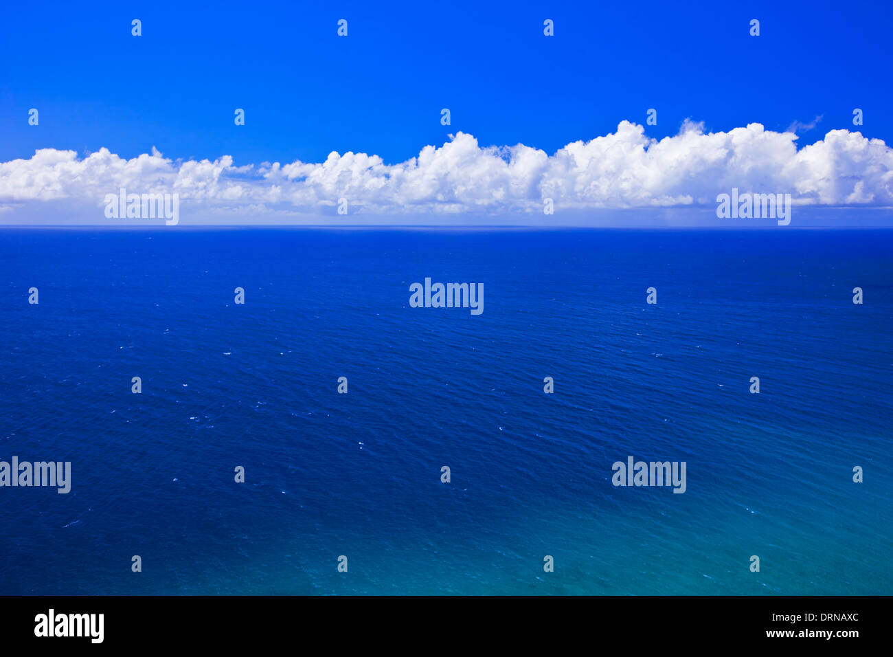 Tropical Ocean and Blue sky with White Clouds - Stock Image