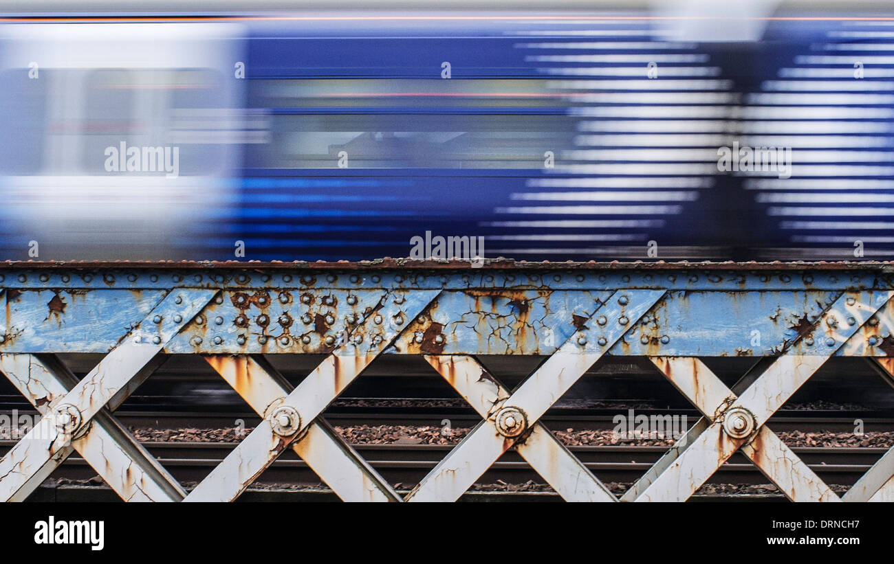 A Scotrail train passes over a bridge on Pointhouse Road, Glasgow, Scotland. - Stock Image